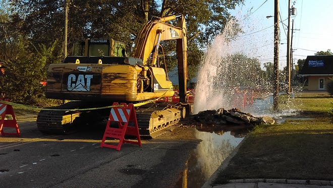 Workers repair a water line break at the intersection of Utica and Valley in Jackson.