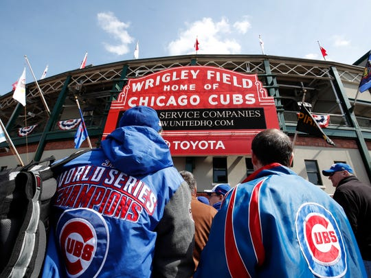 Chicago Cubs' fans line up outside Wrigley Field.