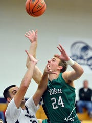 Mike Duffy of York College draws a foul from Messiah's
