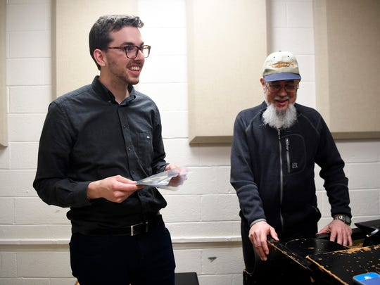 Caleb Rumley, left, who studied jazz under Bridgewater, presents his former teacher with the rare disc, which Rumley's father, Ed, found in a box in his basement.