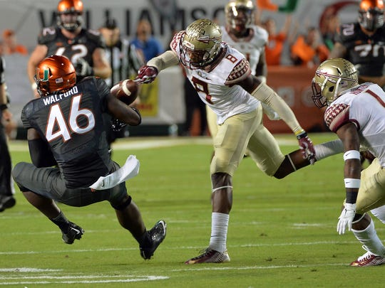 Jalen Ramsey, seen here stripping the ball from Miami Hurricanes tight end Clive Walford, will be moving to corner.