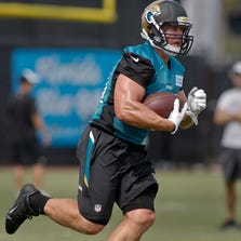 Jul 25, 2014; Jacksonville, FL, USA; Jacksonville Jaguars running back Toby Gerhart (21) runs with the ball during the first day of training camp at Florida Blue Health and Wellness Practice Fields. Mandatory Credit: Phil Sears-USA TODAY Sports