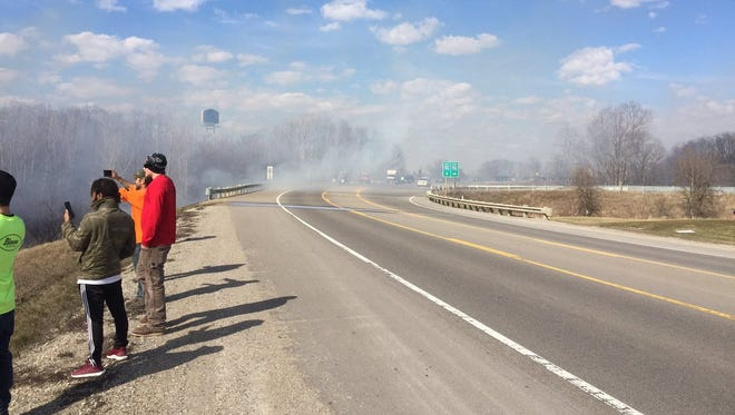 D-19 is closed to traffic south of I-96 due to a large brush fire.