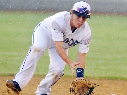 Playing through a steady downpour, West York's Brandon Wetzel fields a grounder in the seventh inning of Thursday's PIAA Class AAA vs. Belle Vernon at Mansion Park in Altoona.