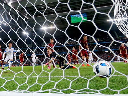 Russia goalkeeper Igor Akinfeev, foreground center, reacts after Slovakia's Marek Hamsik scored his side's second goal during the Euro 2016 Group B soccer match between Russia and Slovakia at the Pierre Mauroy stadium in Villeneuve d'Ascq, near Lille, France, Wednesday, June 15, 2016. (AP Photo/Frank Augstein)