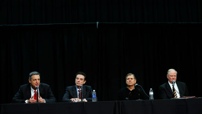 Louisville's President James Ramsey, right, Athletic Director Tom Jurich, coach Rick Pitino and U of L hired investigator Chuck Smrt discuss the self-imposed post season ban for the men's basketball program.