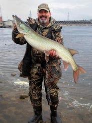Jim Sakowski with a 44-inch muskie from below the Prairie