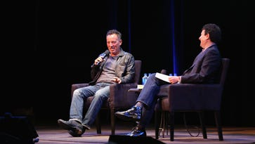 Bruce Springsteen (L) and journalist David Remnick speak onstage during The New Yorker Festival 2016 at Town Hall on October 7, 2016 in New York City.