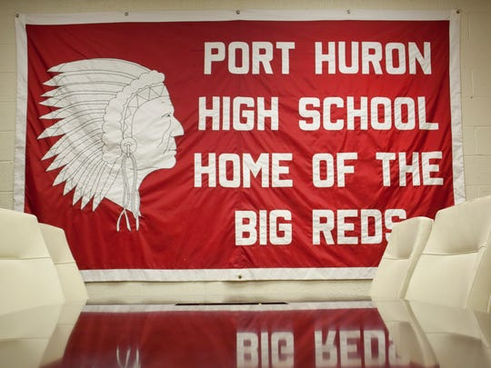 A Big Reds flag is on a wall at Port Huron High School.