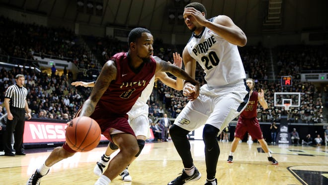 IUPUI guard Darell Combs (0) drives under Purdue center A.J. Hammons (20) in the first half of an NCAA college basketball game in West Lafayette, Ind., Monday, Dec. 7, 2015.  (AP Photo/Michael Conroy)