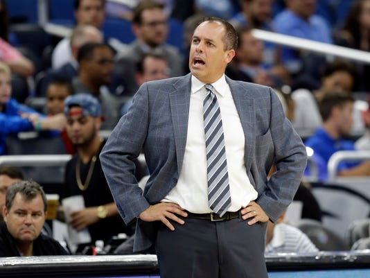 FILE - In this Oct. 14, 2016, file photo, Orlando Magic head coach Frank Vogel disputes a call by officials during the second half of an NBA preseason basketball game against the Indiana Pacers, in Orlando, Fla. The always optimistic Vogel is preparing to begin a new era with the Orlando Magic after being unceremoniously dismissed by the Indiana Pacers.  (AP Photo/John Raoux, File)
