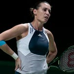 Flavia Pennetta of Italy reacts while she plays against