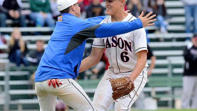 Collin Campbell, left, hugs Mason pitcher Harrison Kinney Wednesday after Kinney stopped a Portland rally in the seventh inning and closed out a 3-2 complete-game victory for the Bulldogs in the Diamond Classic.