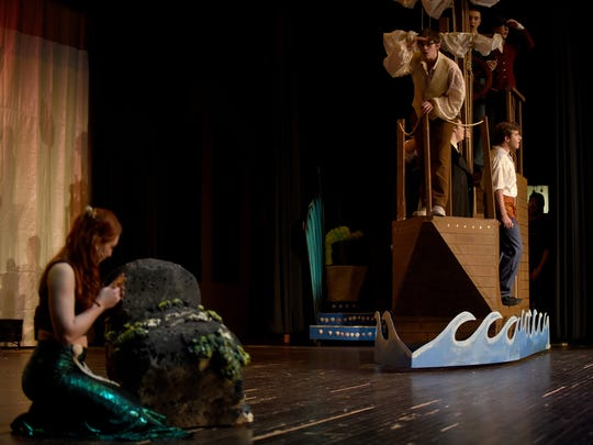 "Lizzie Bowman, as Ariel, hides from crew member John Strawn and Patrick Walker sings ""Fathoms Below"". Newark High School will open their production of ""The Little Mermaid"" at 7 p.m. on Thursday, March 22 with additional shows at 7 p.m. Friday and a kids matinee at 3 p.m. on Saturday . General admission tickets are $10 and $7 for students and senior citizens."