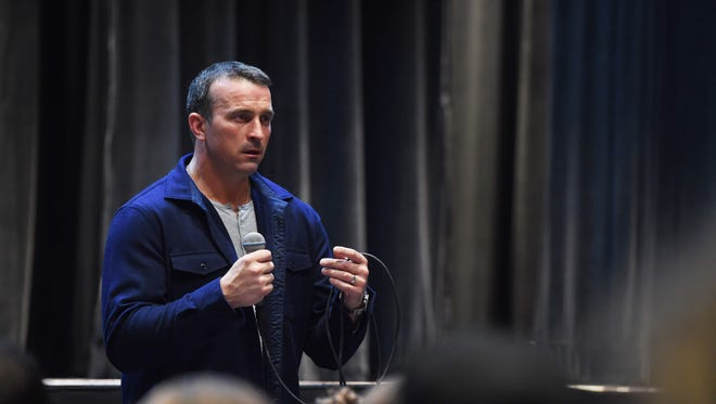 Ex-NBA player and recovering drug addict Chris Herren speaks to a packed auditorium at Arlington High School in Lagrangeville.