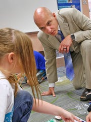 New principal Jered Pennington visits with students in classrooms at Amy Beverland Elementary School on Tuesday, Aug. 23, 2016.  He was named the school's new principal, filling the role left vacant after its previous principal, Susan Jordan, was killed in a tragic accident when a bus jumped the curb and hit her during school dismissal  in January  2016.  He visits the classrooms regularly and interacts with the kids.