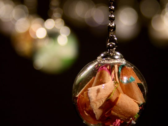 Tiny objects encased in miniature bottles represent
