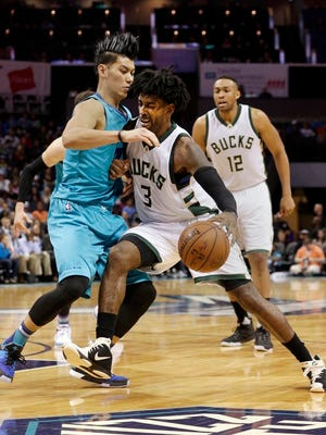Milwaukee Bucks guard O.J. Mayo (3) collides with Charlotte Hornets guard Jeremy Lin in the second half of an NBA basketball game in Charlotte, N.C., Sunday, Nov. 29, 2015.