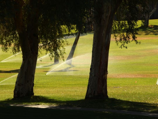 Sprinklers water a section of the Mission Hills Country Club in Rancho Mirage during the ANA Inspiration LPGA golf tournament on Friday. The Coachella Valley features 123 golf courses, some of which use recycled water.