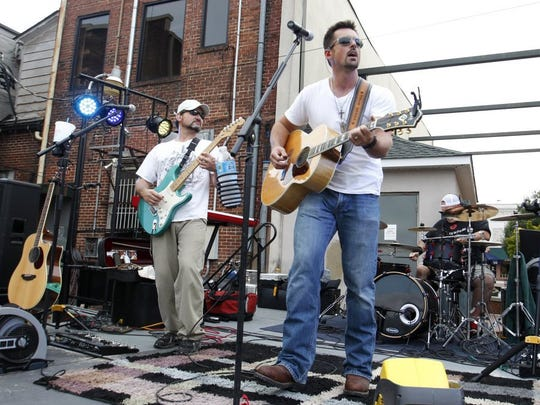 The Eric Scott Band performs at the Anderson Block Party in Carolina Wren Park.