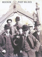 A group of young men stop for a picture at the Housum Post No. 309 on West Queen Street in the late 1800s.