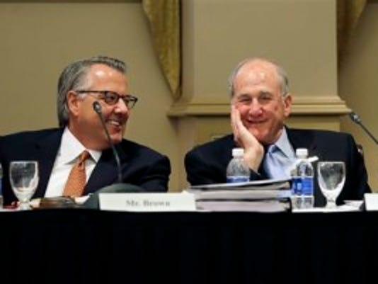 Greg Brown, left, chairman of the Rutgers University board of governors, and Rutgers president, Robert Barchi share a laugh before a public meeting, Thursday, June 18, 2015, in New Brunswick, N.J. The board of governors discussed a master building plan that includes upgrades to the university's athletic facilities. (AP Photo/Mel Evans)