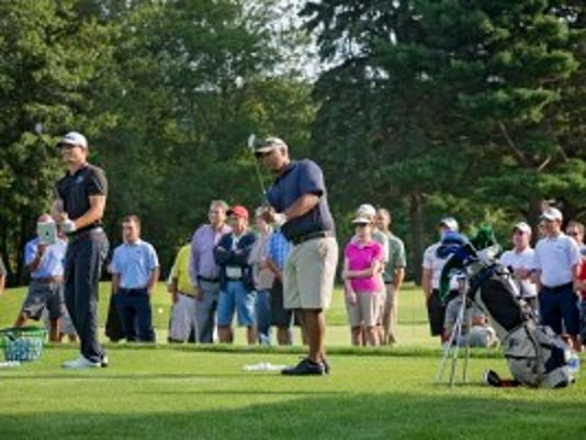 PGA pro Morgan Hofmann, left, gives a one-on-one lesson to Army Master Sgt. John Cruz. Photo courtesy of Picatinny Arsenal