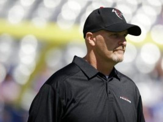 Atlanta head coach Dan Quinn of Morristown walks on the field at MetLife Stadium on Sunday. (AP Photo/Seth Wenig)