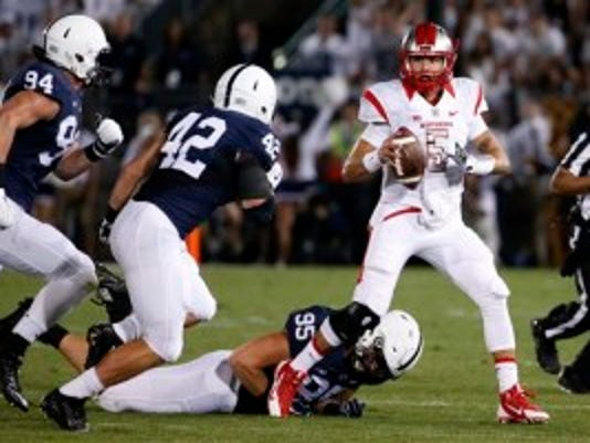 Rutgers quarterback Chris Laviano (5) scrambles out of the pocket under pressure from Penn State defensive end Carl Nassib (95), linebacker Troy Reeder (42) and defensive end Evan Schwan (94) during the first half of an NCAA college football game in State College, Pa., Saturday, Sept. 19, 2015. (AP Photo/Gene J. Puskar)