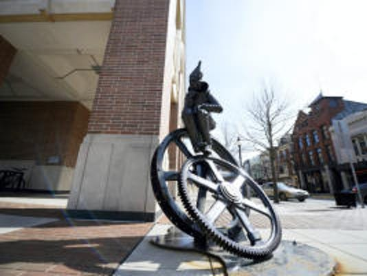 The Tin Man sculpture by Salvaging Creativity sits on the corner of North George and East Philadelphia Streets in York Thursday, March 19, 2015. The artist who created the sculpture was accused of stealing a gear used in the sculpture.