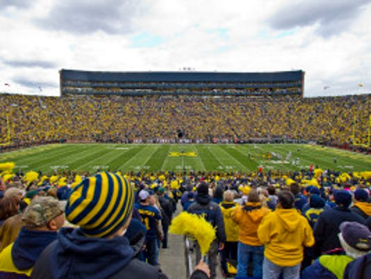 Michigan Stadium viewed in the first quarter of an NCAA college football game between Michigan and Michigan State in Ann Arbor, Mich., Saturday, Oct. 17, 2015. (AP Photo/Tony Ding)