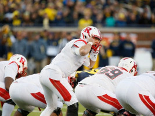 Rutgers' Chris Laviano calls an audible during the first half of an NCAA college football game against Michigan Saturday, Nov. 7, 2015, in Ann Arbor, Mich. Michigan defeated Rutgers 49-16. (AP Photo/Duane Burleson)
