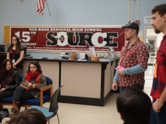 Project R.E.A.L. coordinators talk to students at Red Bank Regional. Courtesy of the high school.