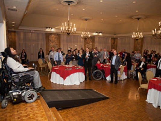 "Paralyzed former Rutgers football player Eric LeGrand received a standing ovation from the crowd as he took the stage at last year's ""An Evening with Eric LeGrand"" fundraiser hosted by Newroads Financial Group. (Photo: Courtesy of Newroads Financial Group )"