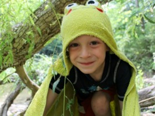 """Kids deserve to have fun, down-time, and empty spaces in their lives to fill any way they choose to.... Unscheduled time encourages children to create, imagine, see new possibilities that no one before has thought of."" Robert Coles (""Jack as a Frog,"" photo courtesy of Beth Lathrop)"