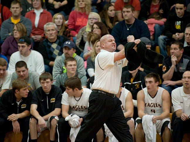 Colonel Crawford coach David Sheldon works the sidelines during a game against his alma mater Wynford earlier this year. He was named News Journal Boys Basketball Coach of the Year for 2014-15.