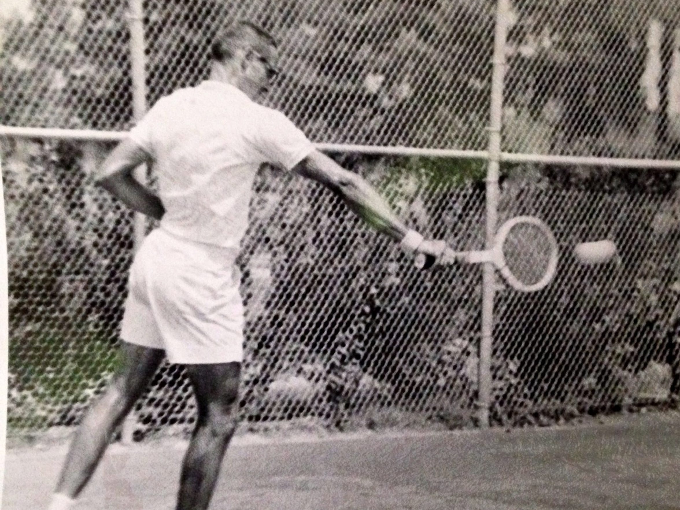 Tom Robinson is shown hitting a backhand in competition