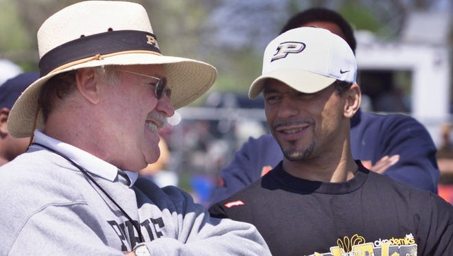 Purdue coach Joe Tiller, left, and former Boiler All-American Rod Woodson chat at the University of Saint Francis in Fort Wayne on Saturday April 26, 2003. Woodson was at the Spring Game.