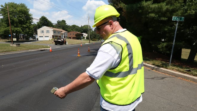 Rockland County Highway Department foreman Bernie Hughes working on South Little Tor Road in New City in July 2016.