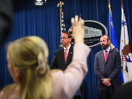 Deputy Attorney General Rod Rosenstein holds at a news conference, Wednesday.
