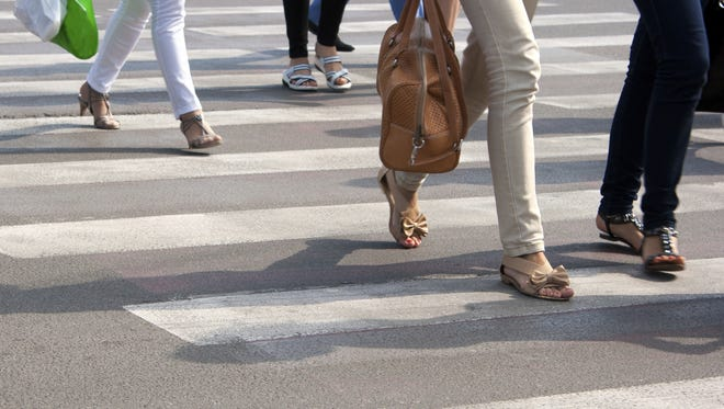 Stock photo: Feet on the pedestrian crossing