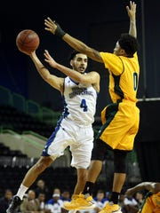 Islanders' Ehab Amin passes the ball against Southeastern