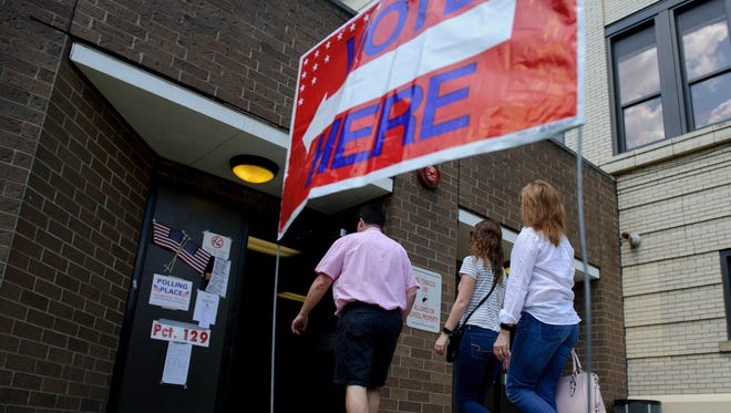 Voters head into the polls outside the Tridelphia Middle School polling place on May 8, 2018 in Wheeling, West Virginia. West Virginia voters headed to the polls Tuesday to vote in the Spring primaries. (Photo by Jeff Swensen/Getty Images)