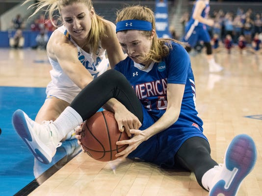 American guard Maria Liddane, right, and UCLA guard Chantel Horvat fight for a loose ball during the first half of a first-round game in the NCAA women's college basketball tournament , in Los Angeles, Saturday, March 17, 2018. (AP Photo/Kyusung Gong)