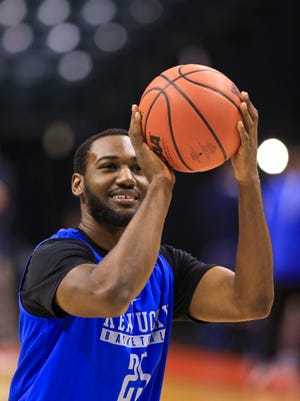 Kentucky's Dominique Hawkins takes some practice shoots during the Wildcats shoot-around Thursday in Indianapolis for the NCAA tournament.