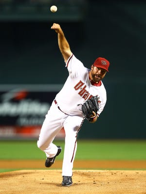 Homer native Josh Collmenter was traded to the Atlanta Braves on Wednesday.