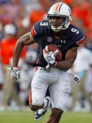 Auburn safety Jermaine Whitehead returns an interception for a touchdown Saturday against Arkansas.