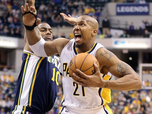 Pacers David West drives on Utah Jazz F Alec Burks in the first half of their game as the Pacers beat the Jazz 94-91 Sunday.