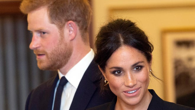 """Prince Harry and Duchess Meghan of Sussex at the Victoria Palace Theatre before attending a charity gala performance of """"Hamilton"""" in London on Aug. 29, 2018."""