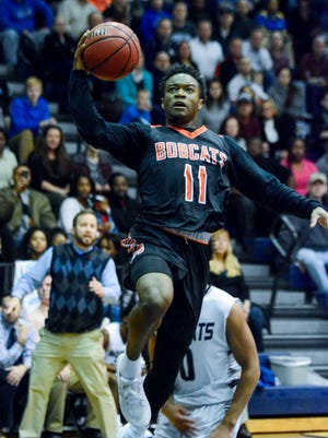 Fred Mulbah (11) has been a key part in helping Northeastern successfully make the jump from Division II to Division I this season and has the Bobcats in the league tournament semifinal round. John A. Pavoncello